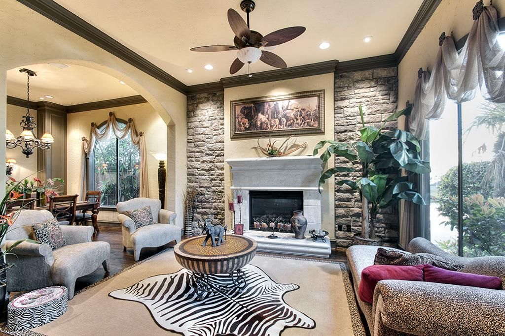 Formal Living Room With Stone Accent Wall Limestone Fireplace And Hardwood Floor