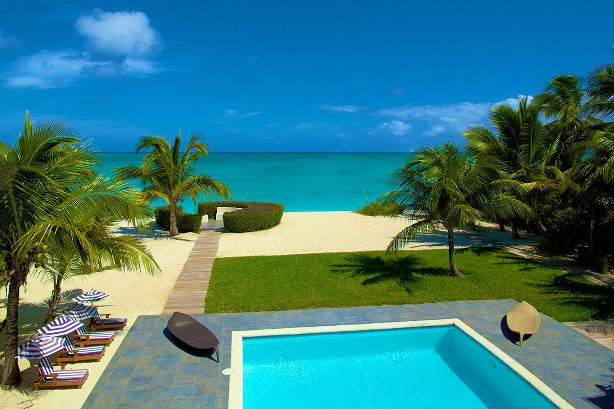 Footprints On The Beach Turks And Caicos Luxury Retreats