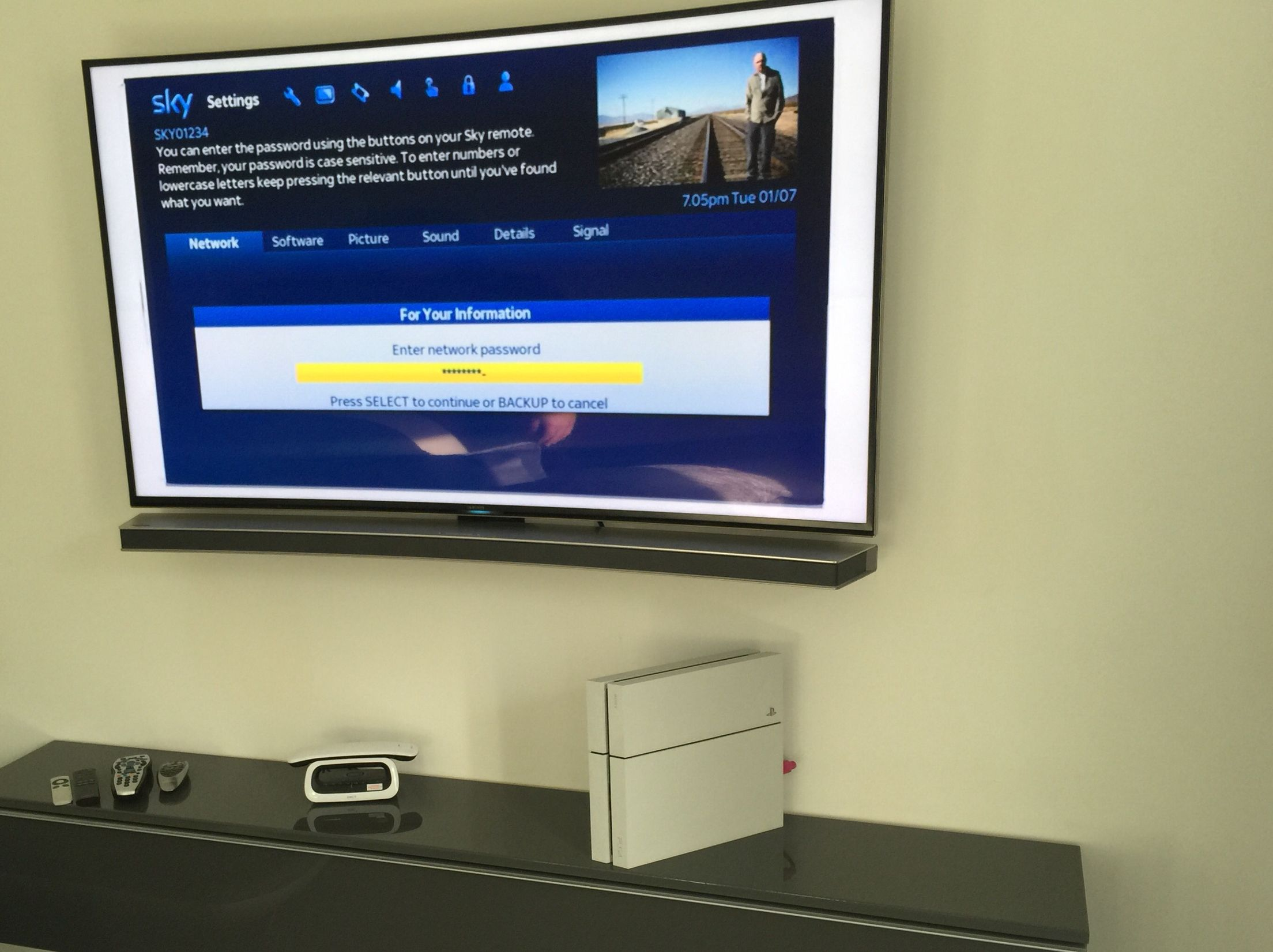 """55"""" curved Samsung and a curved soundbar wall mounted ..."""