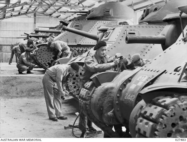Work being carried out in the Driver and Maintenance (DM) hangar on some M3 Grant medium tanks at the Army Armoured Fighting Vehicle (AFV) School. All the vehicles look in new condition and have ...