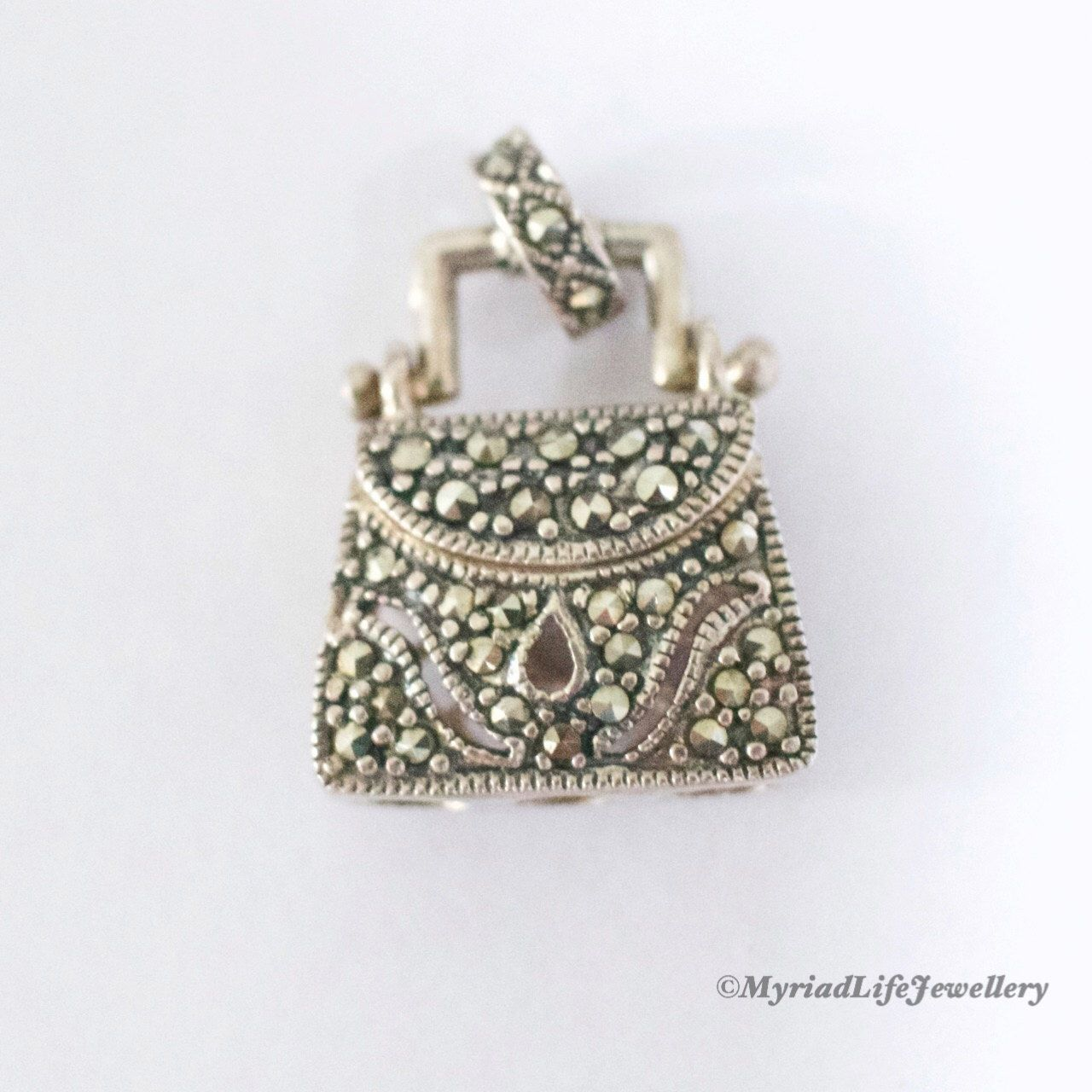 925 Silver Marcasite Handbag Purse Charm or Pendant by MyriadLifeVintage on Etsy https://www.etsy.com/uk/listing/465421143/925-silver-marcasite-handbag-purse-charm