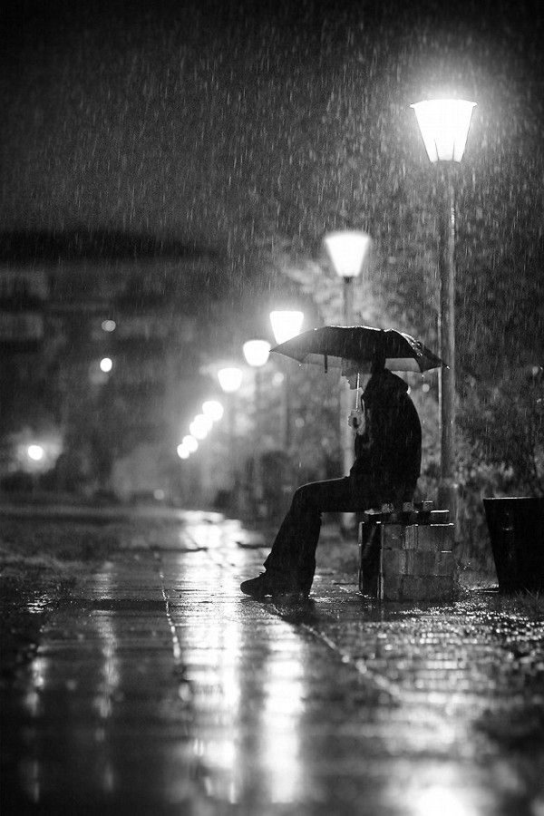 Image result for a child sitting alone in the rain