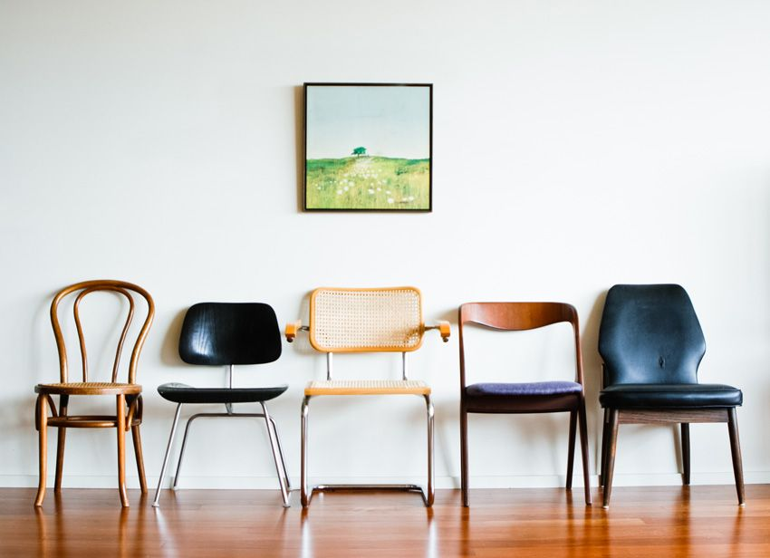 Mismatched chairs... great waiting room idea for a clinic ...