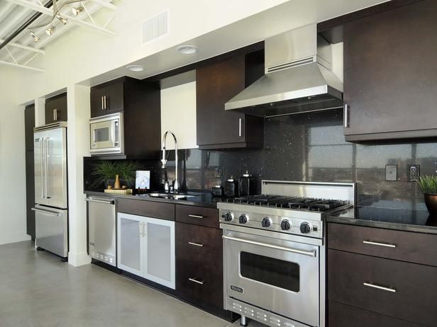 Small space kitchen dark brown cabinets a black for Brown kitchen cabinets with black appliances