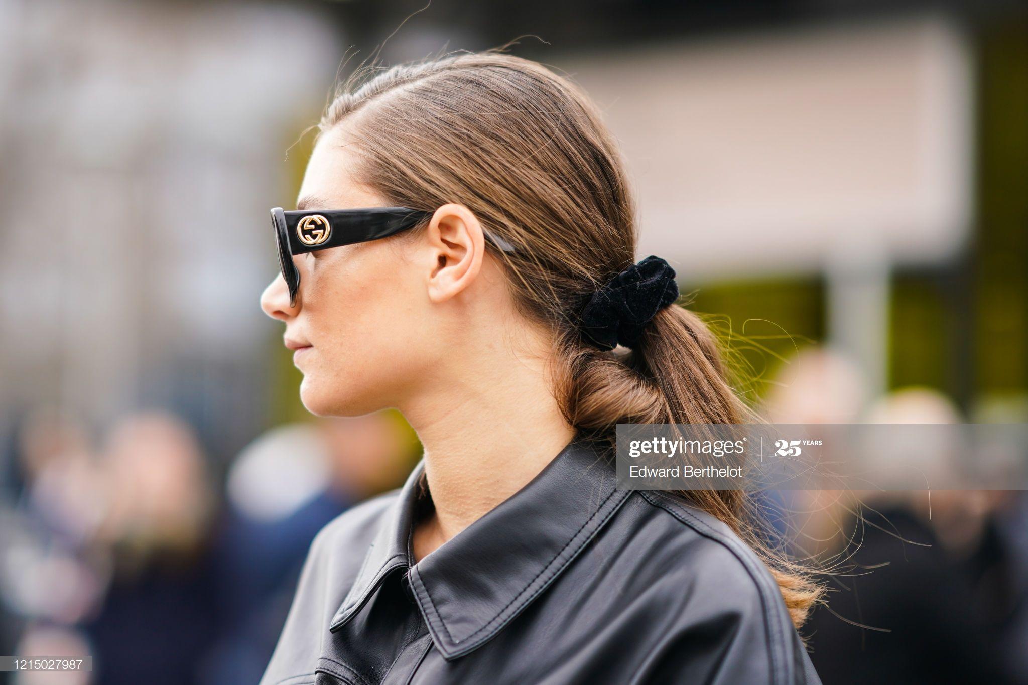 A Guest Wears Gucci Sunglasses Outside Balmain During Paris Fashion
