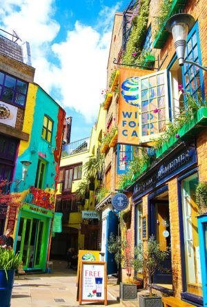 A secret courtyard in the colorful Covent Garden of London. www.kevinandamanda.com #travel #london #color