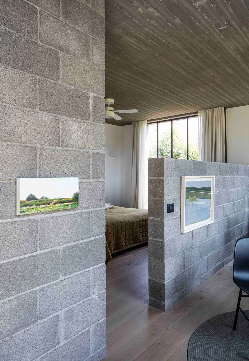 Unfinished Concrete Gives This House An Industrial Feeling Cinder Block House Concrete Houses Concrete Block Walls