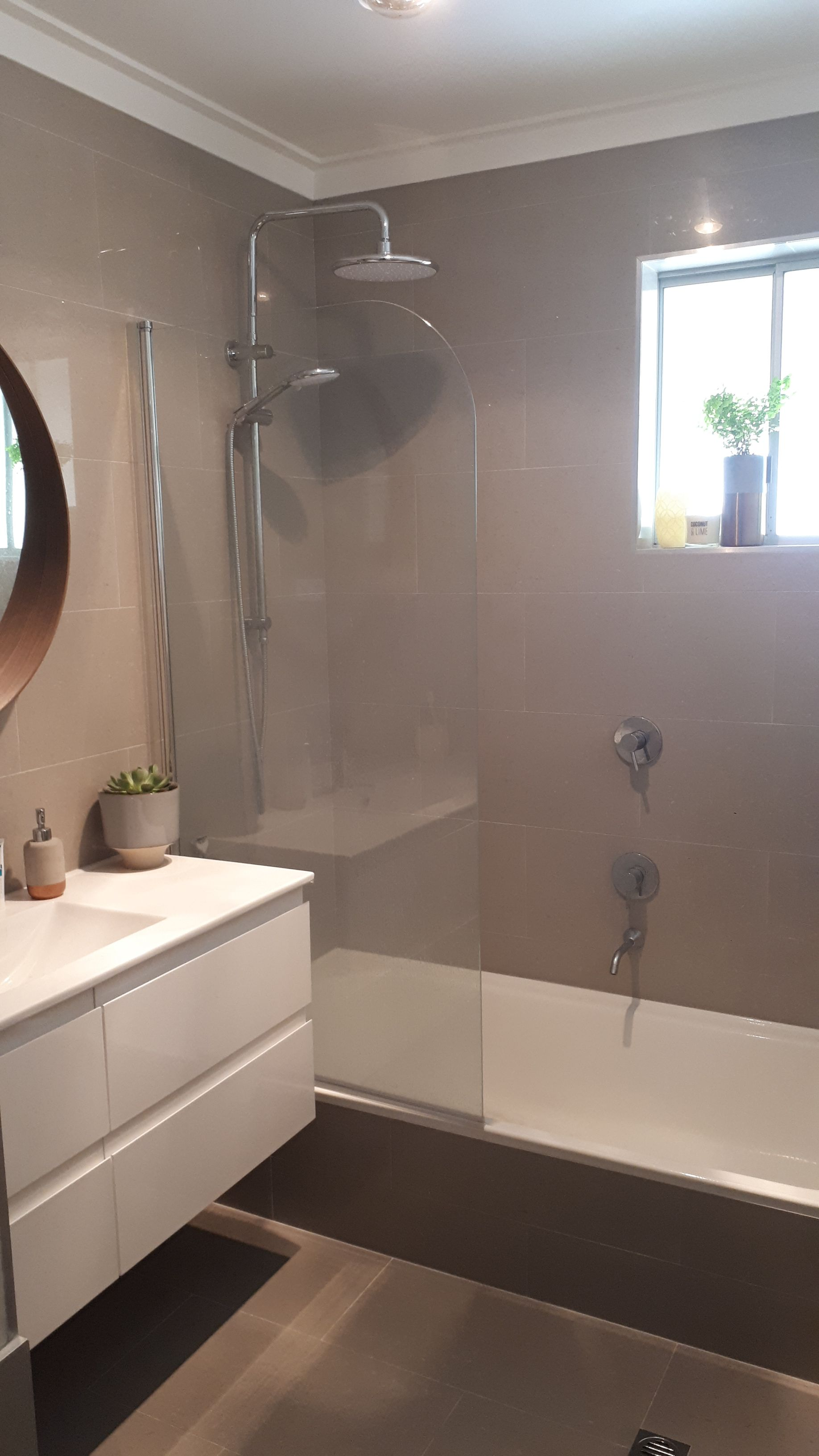 Grey Floor & wall tiles with all white floating vanity