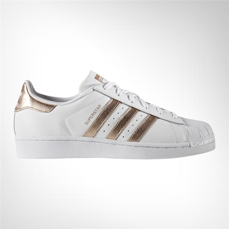 These women's shoes add some glimmer to the heritage style of the adidas  Superstar sneaker with rose gold-tone and heel patch