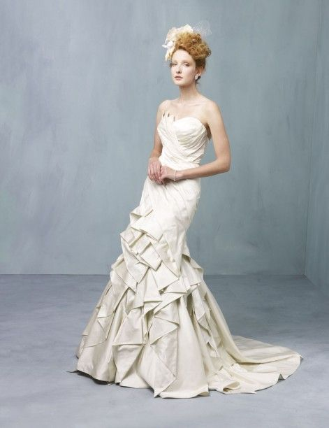 Anise A dramatic mermaid gown with intricate folds and pleats ...