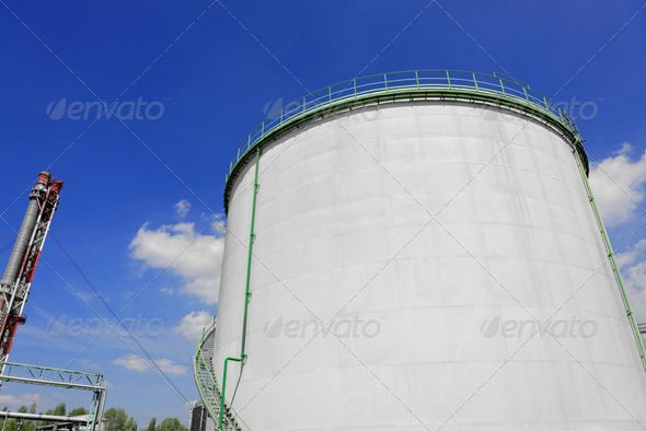 Large industrial silo with blue sky ...  agriculture, blue, building, circle, container, curve, cylinder, exhaust, factory, grey, industrial, industry, metal, modern, shiny, silo, sky, stair, staircase, storage, white