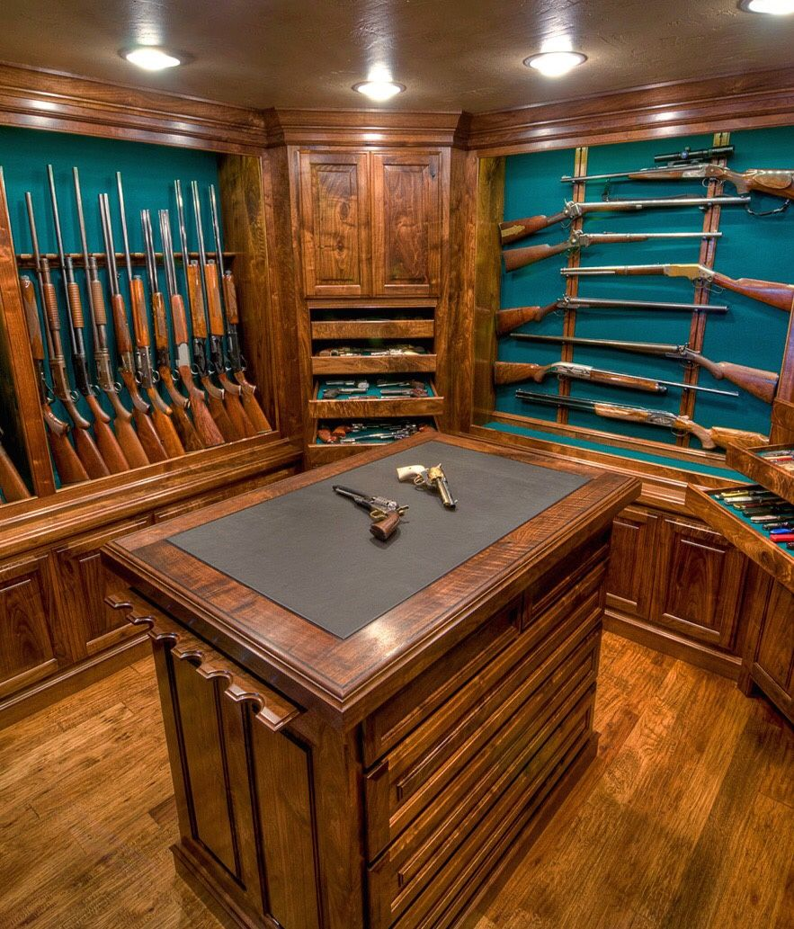 My dream gun room for collecting. I love all the wood and the gun rests at the end of the workbench.