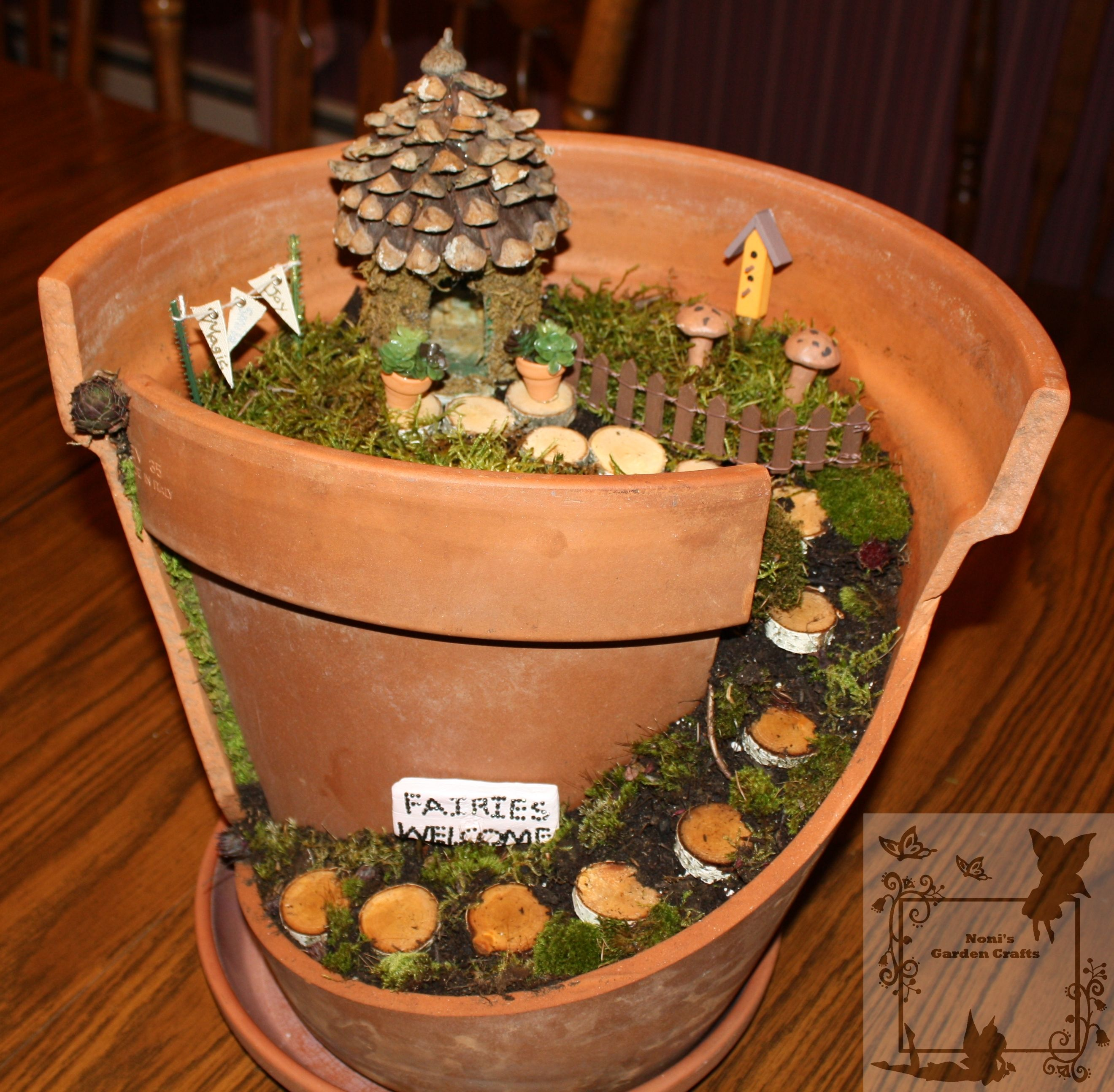 Terracotta pots fairy houses terra cotta pot fairy for Craft ideas for fairy gardens
