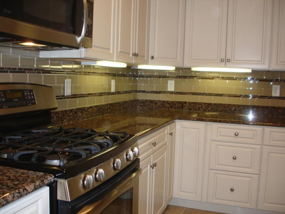 baltic brown granites surface has warm brown golden and gray big rigid circles circles glass tile backsplashbacksplash ideastile