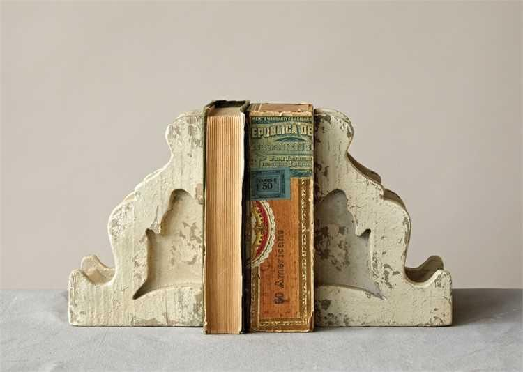 """These ah, ah, AMAZING Distressed White Magnesia Corbel Bookends are reminiscent of days of yore. Corbels were once used with abandon when adorning old farmhouses and came in all shapes and sizes. Their intricacies are what made, and make them such a timeless heirloom. Bring the new charm of old style into your home with a set of these fantastic beauts!    They measure 5.25""""W x 4""""D x 8""""T."""