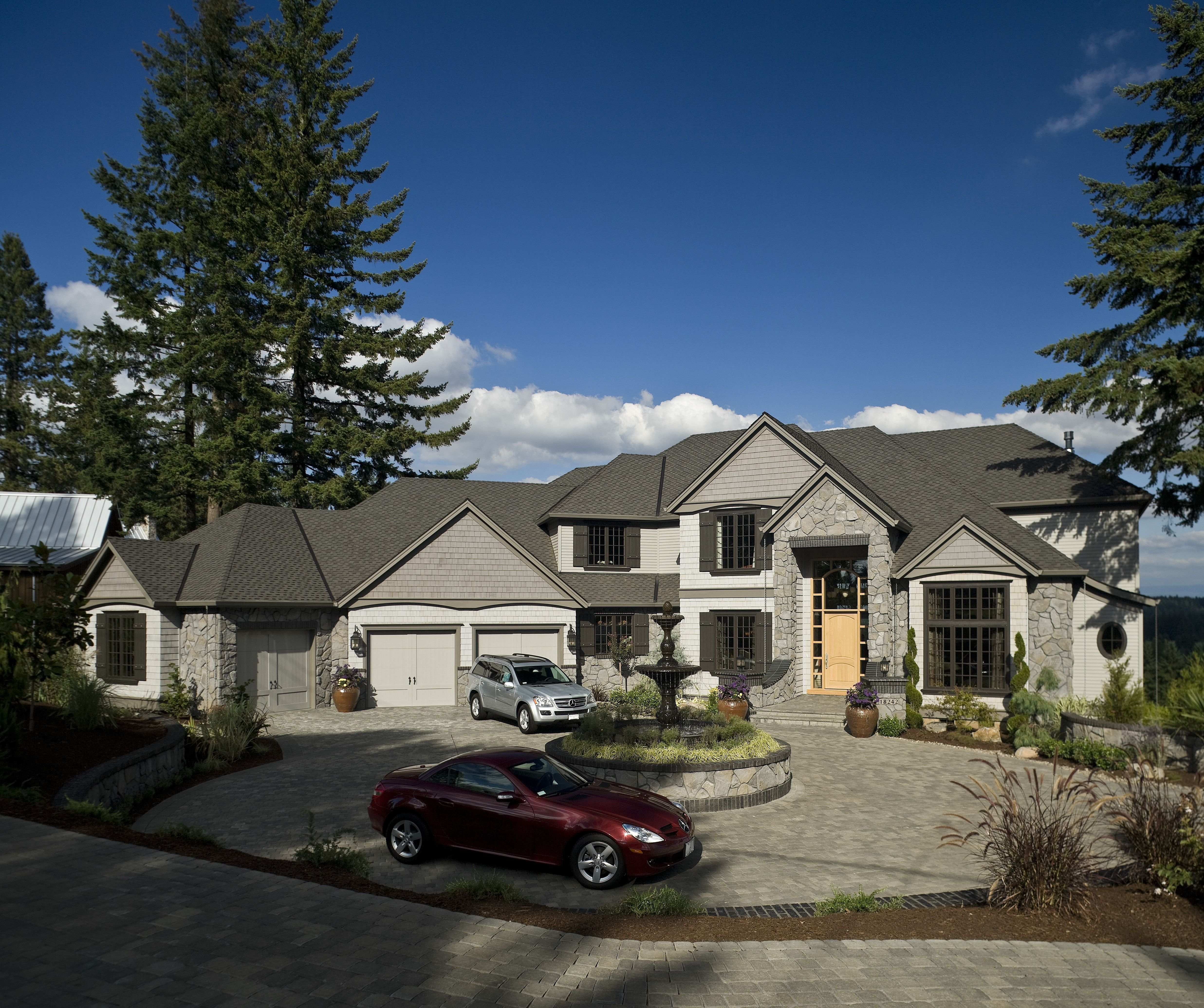 The Circular Driveway And Light Wood Door Are Great Additions To This Home The Gray Exterior Is Also Beautiful Click To See Front View Of House House Exterior