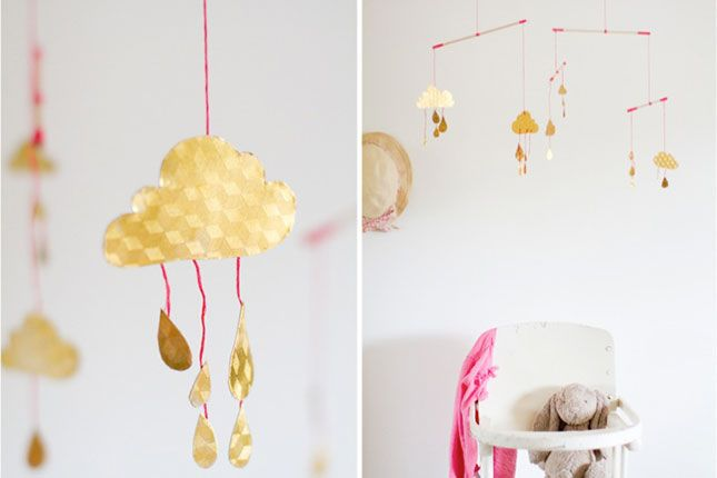 Use wooden dowels, embroidery thread and gold foil paper to make this modern mobile.