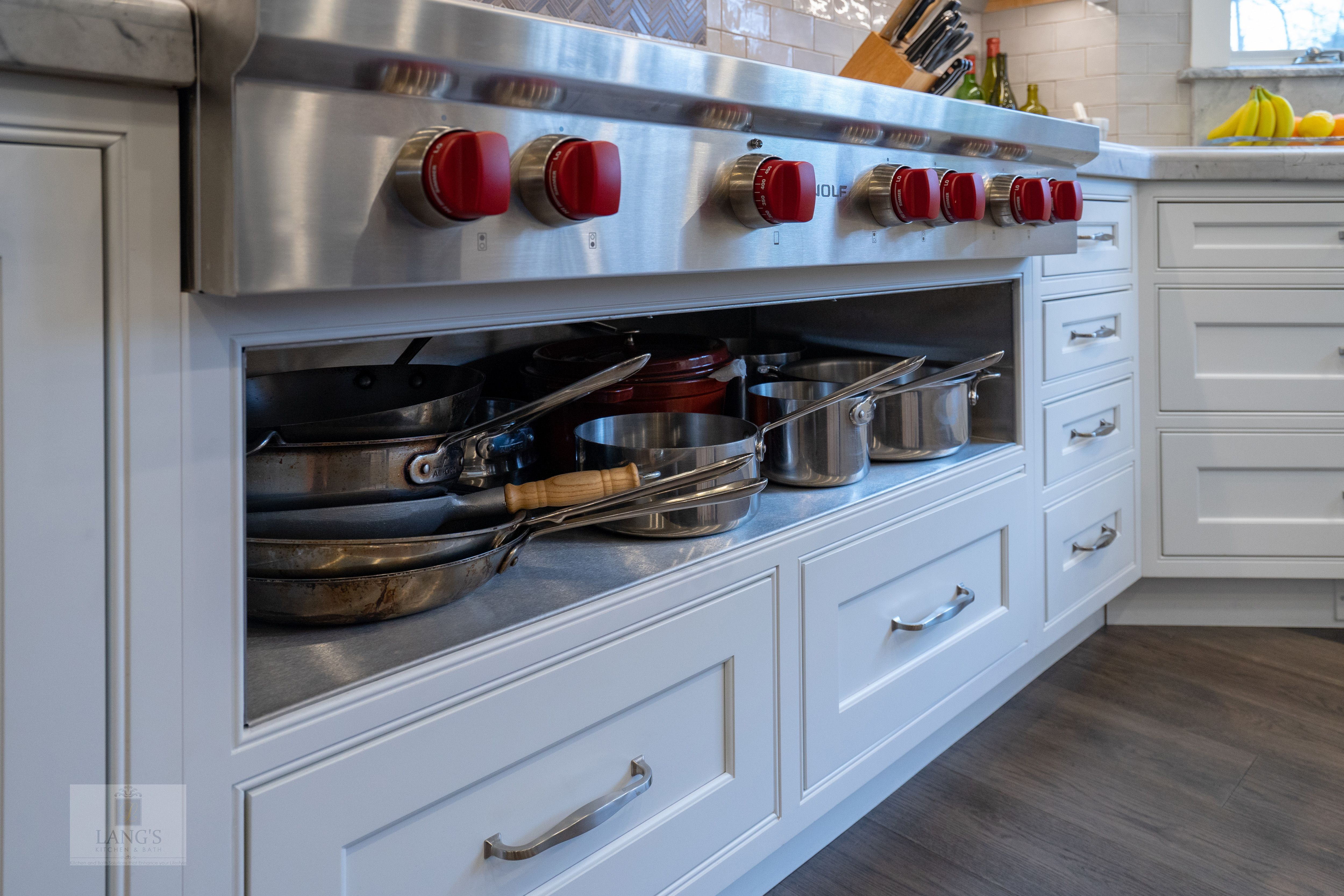 this transitional style kitchen remodel is the heart and soul of
