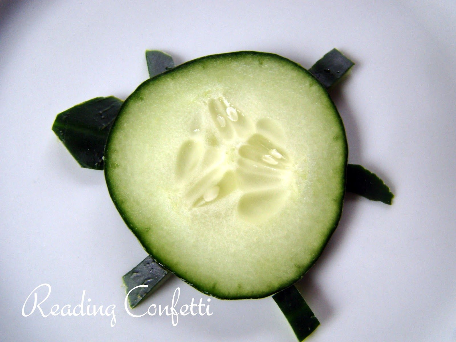 Reading Confetti: see?  turtle cucumbers!  Let the kids decorate the shells with toppings of hummus and veggies?