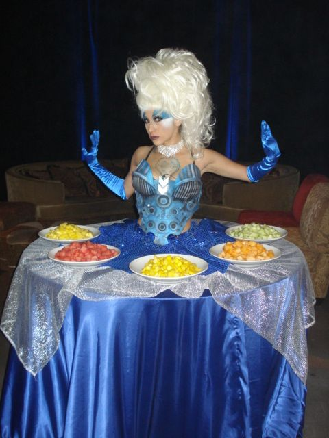Blue End of the World style strolling table diva by J & D Entertainment Houston, Houston living table, human table