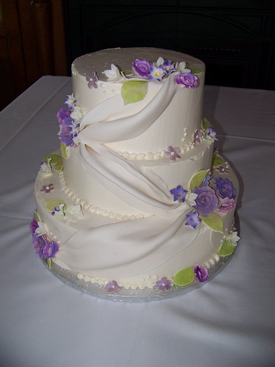 simple fondant wedding cakes buttercream wedding cake with fondant swag and purple 19986
