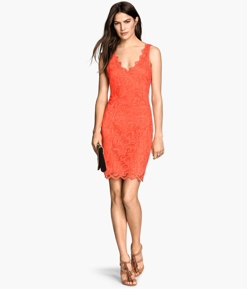 Short fitted dress in orange lace with front u back lowcut vneck
