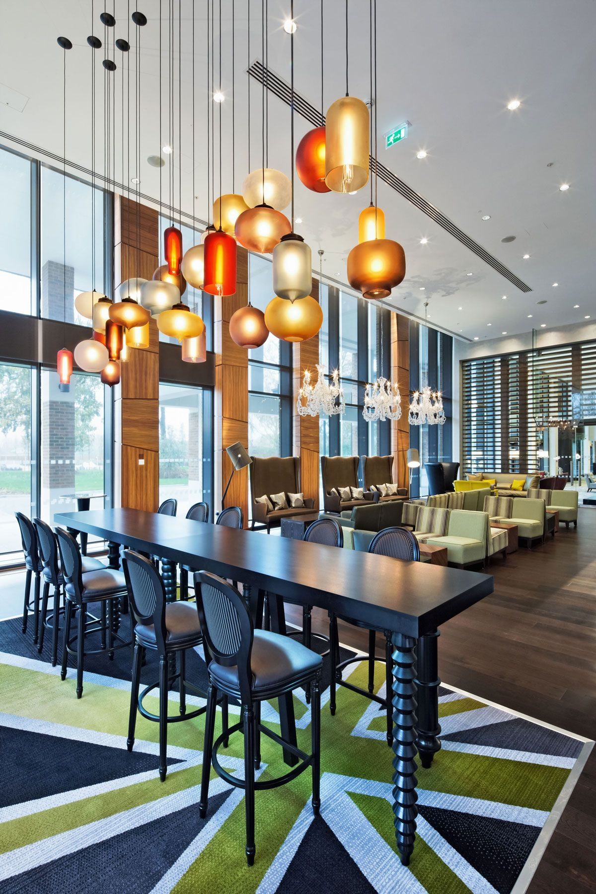 Contemporary Pendant Lighting For Dining Room hanging lighting fixtures above island dining room contemporary with modern dining chairs contemporary pendant lights Niche Modern Pendant Lighting At The Hilton At Heathrow In London Eclectic Dining Room London Niche Modern