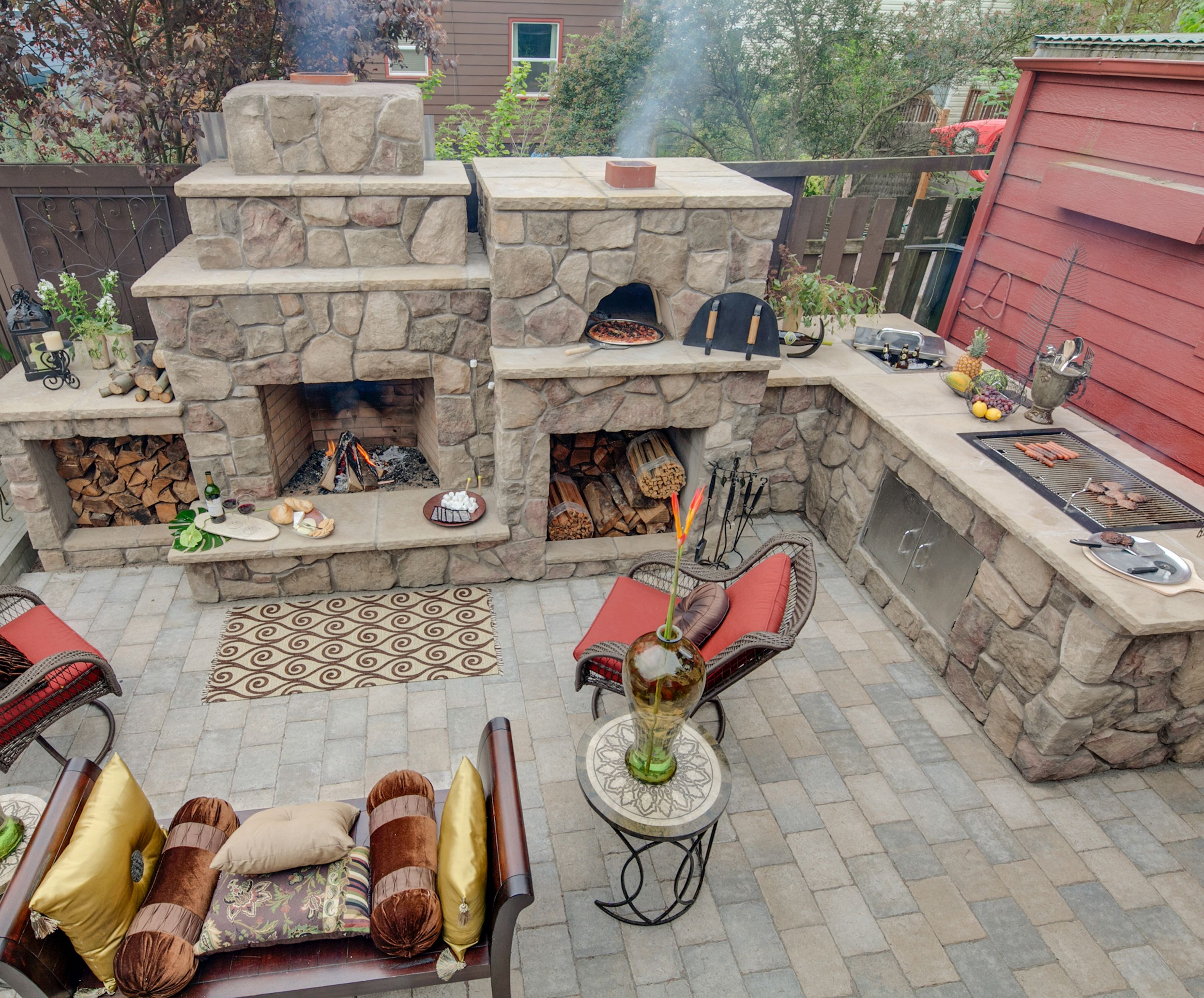 wrap around fireplace pizza oven and kitchen grill area http