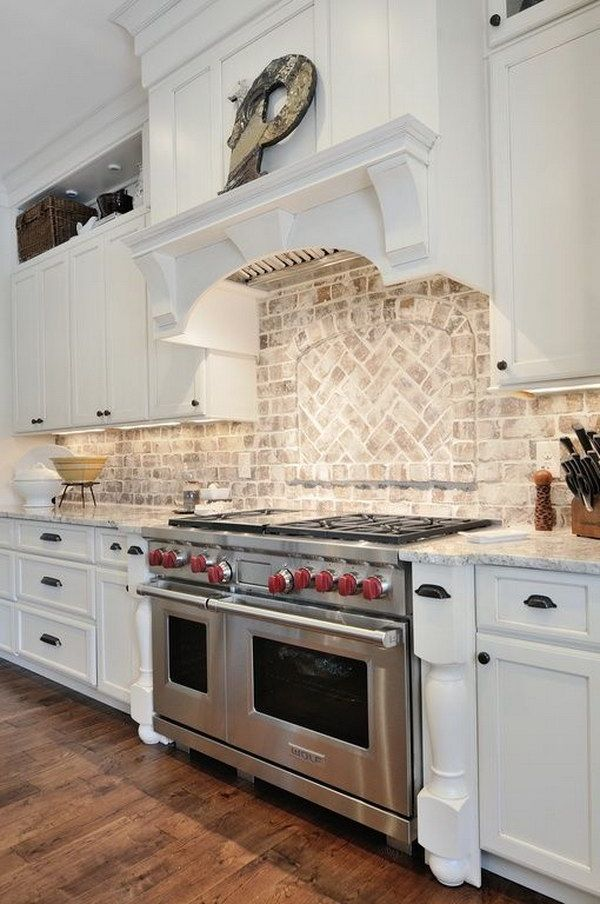 A Light, Aged Brick Backsplash in a Traditional White Kitchen