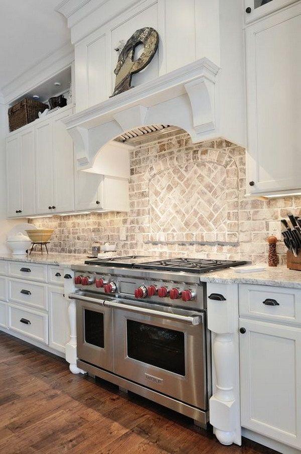 A Light Aged Brick Backsplash In A Traditional White Kitchen