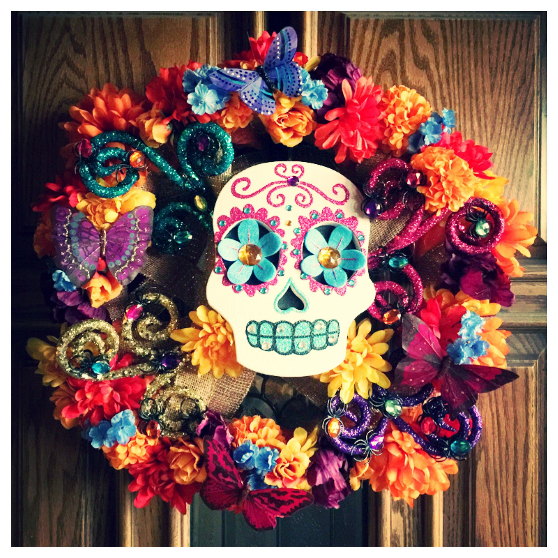 dia de los muertos wreath made with burlap butterflies jeweled spiders flowers and