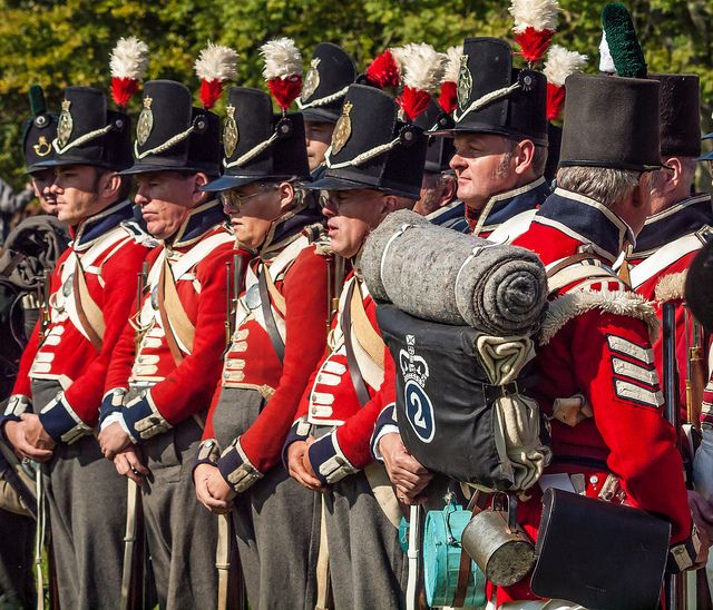 A reenactment group in the British army red coat uniform of the ...