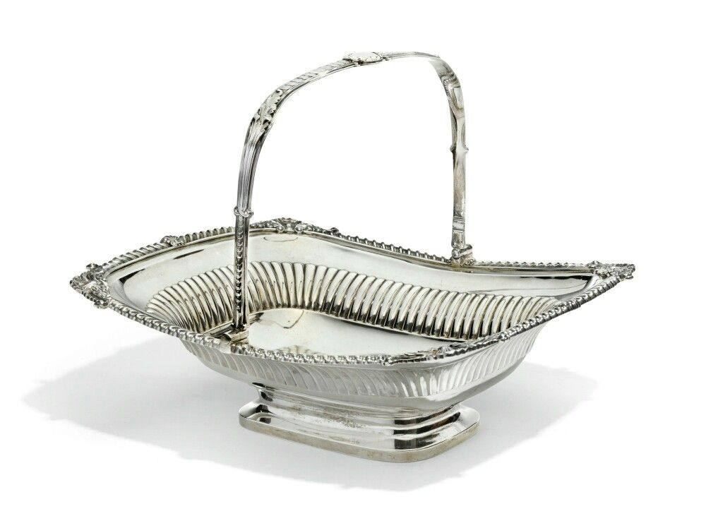 A George III silver swing-handle basket, Paul Storr, of Paul Storr & Co., for Rundell, Bridge & Rundell, London, 1812.