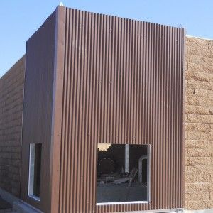 Awesome Corrugated Metal Siding With Picture Window And Faux Stone Siding  For Exterior Design