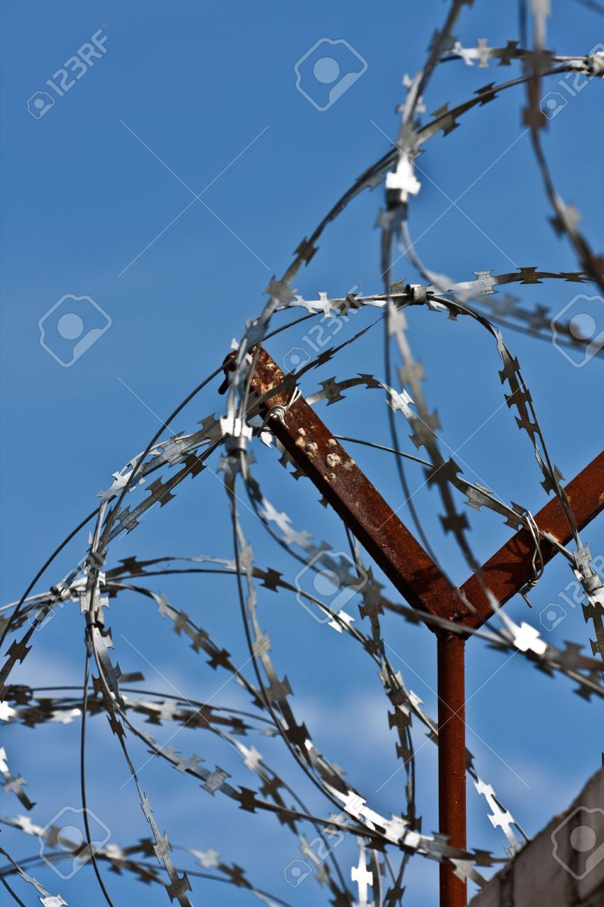 My new Pin 5262417-A-barbed-wire-fence-with-razor-sharp-wires-Stock ...