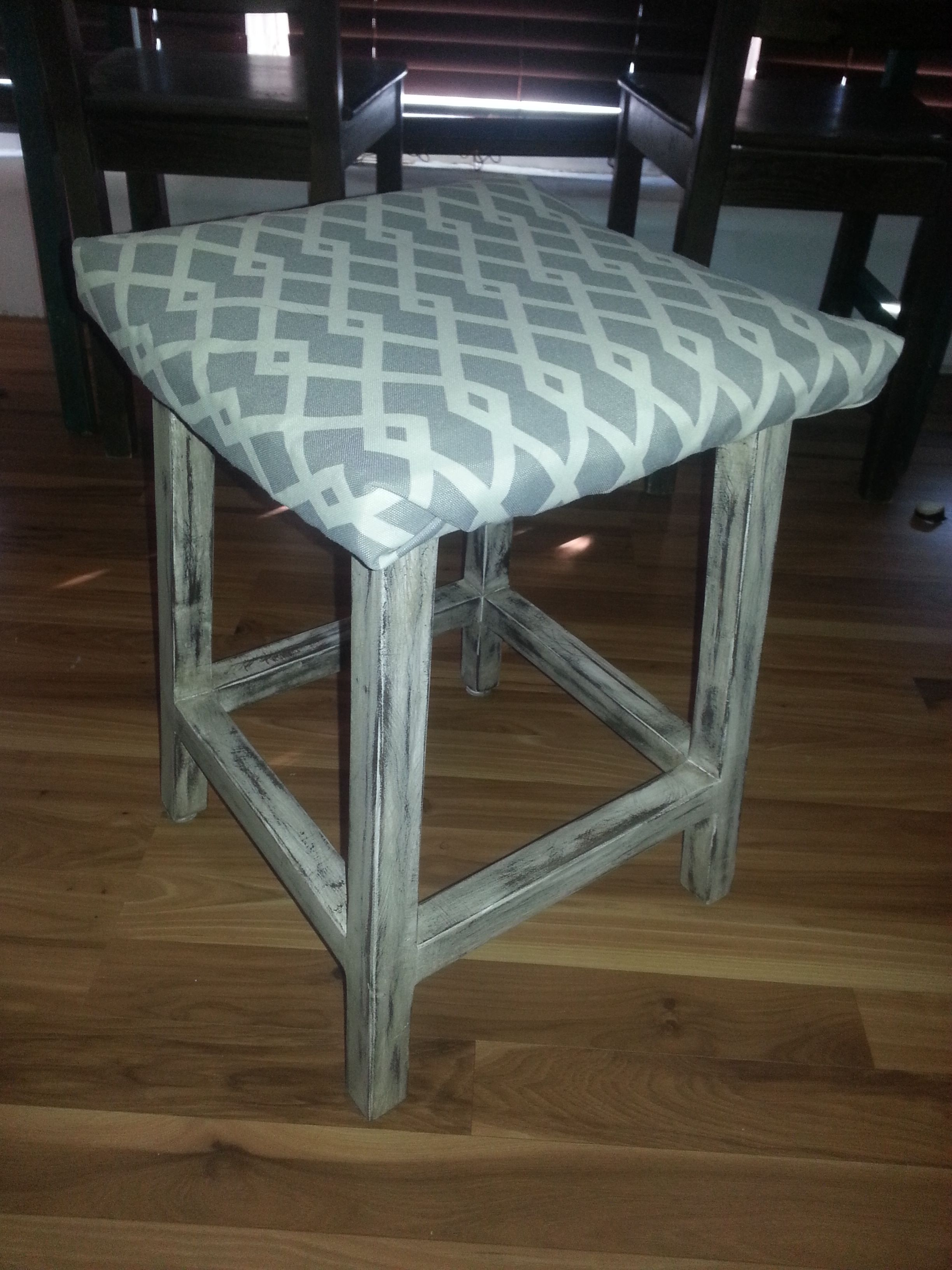 Refinished stool. I sanded and aged the wood, then cover the wicker top with thin piece of cotton and cover with fabric.