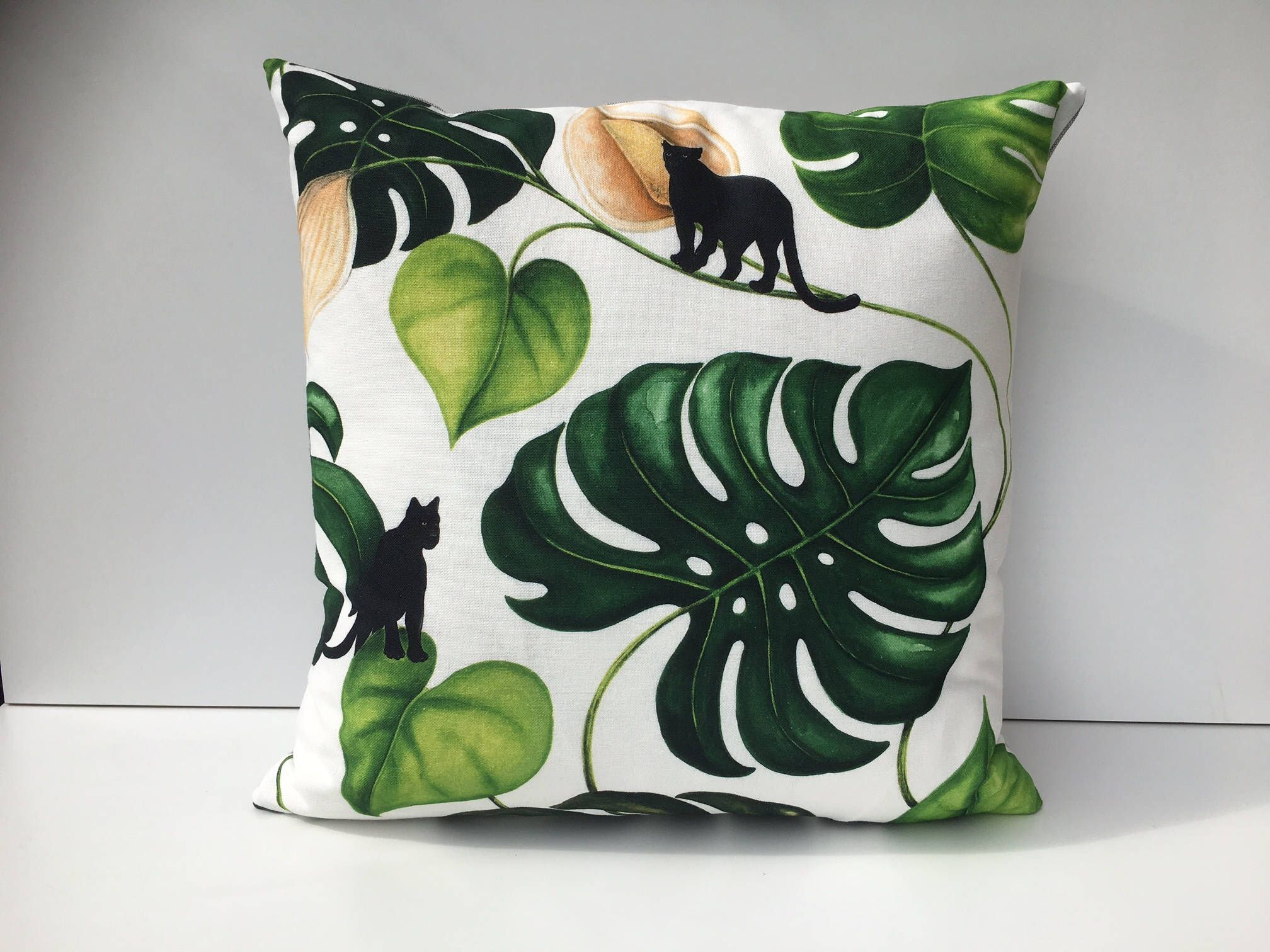 Cushion cover in monstera cheeseplant black cat panther design