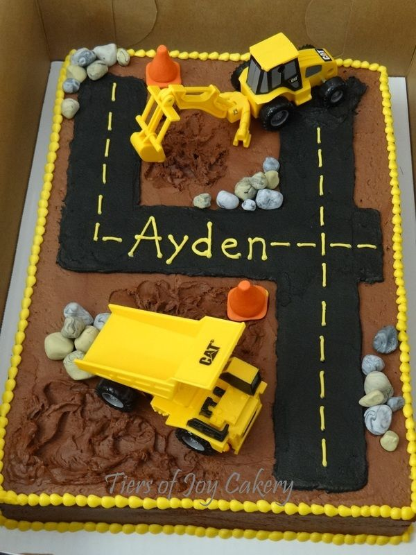 Construction cake with construction equipment (toys) and fondant rocks and cones.