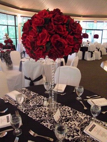 Centerpieces and tableclothes.. Love the black and white.. The red is beautiful..