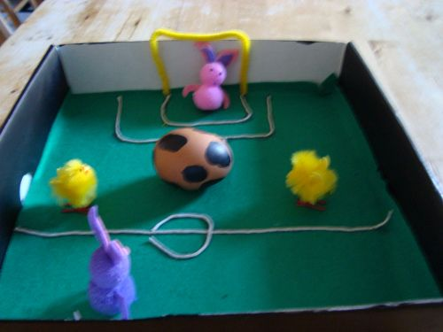 Easy #football scene for school's #Easter egg decorating competition! Simply use an old shoebox lid, paint like a football field and decorate an egg to look like a football. Don't foget to add chick players! #soccer