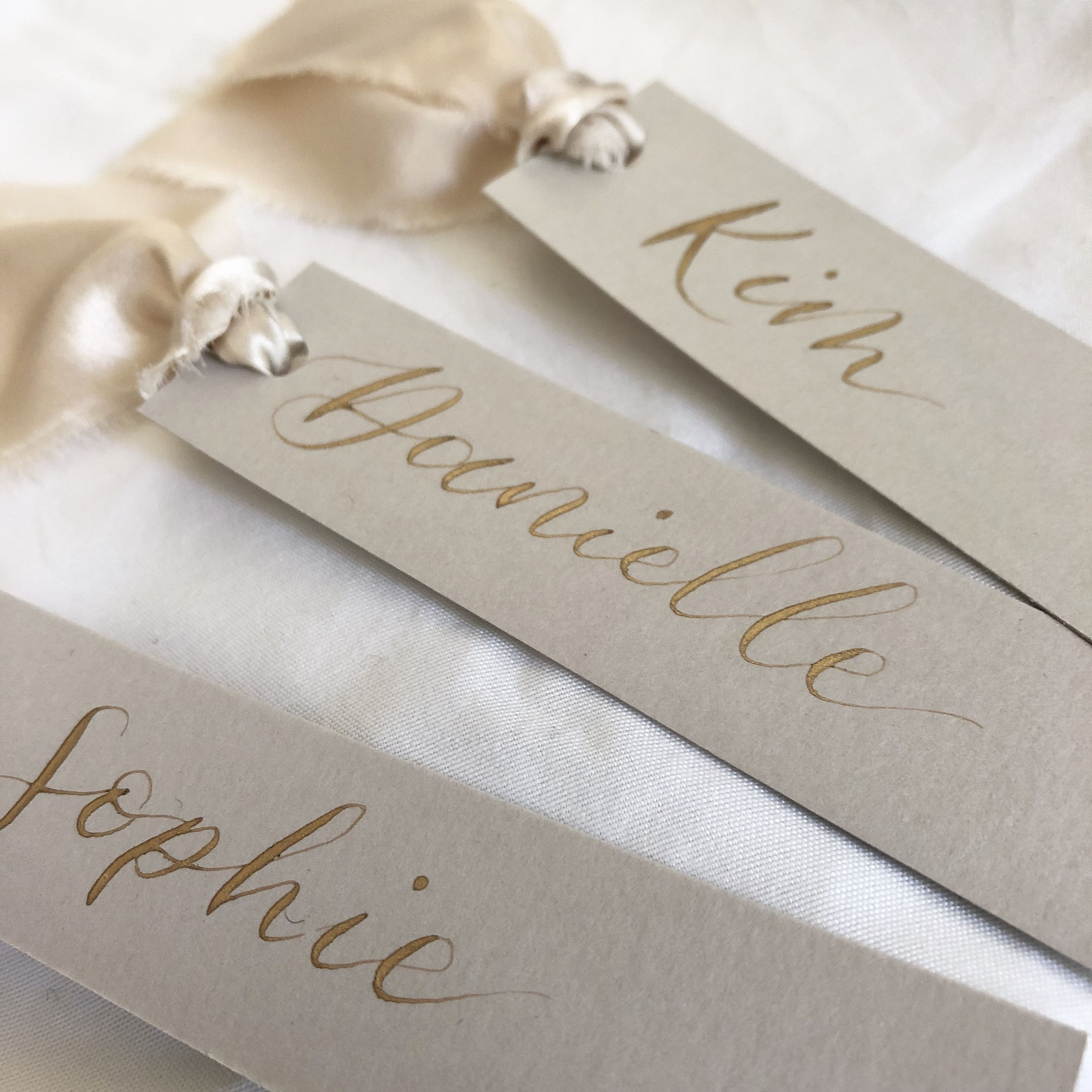 place cards silk ribbon gold ink  wedding stationery