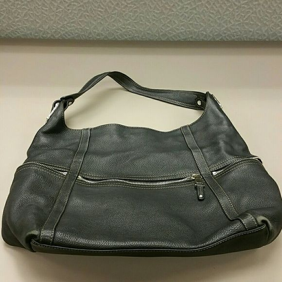 Large Tignanello satchel Large Tignanello satchel. Real pebble leather. Signature lining all throughout bag. Multiple pockets inside and 2 zipper pockets on sides of purse. Normal wear. No tears or rips. Silver hardware. Tignanello Bags Satchels