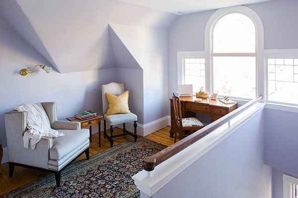 A third-floor space at the top of the stairs serves as a home office.