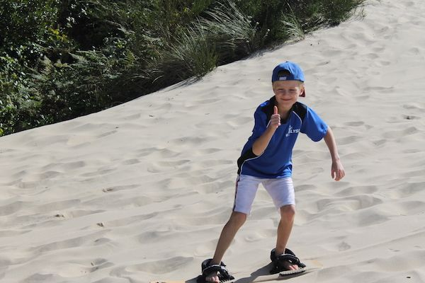 Sandboarding is a popular and fun family activity; and there's no better place to learn than the Oregon Dunes near Florence, Oregon.