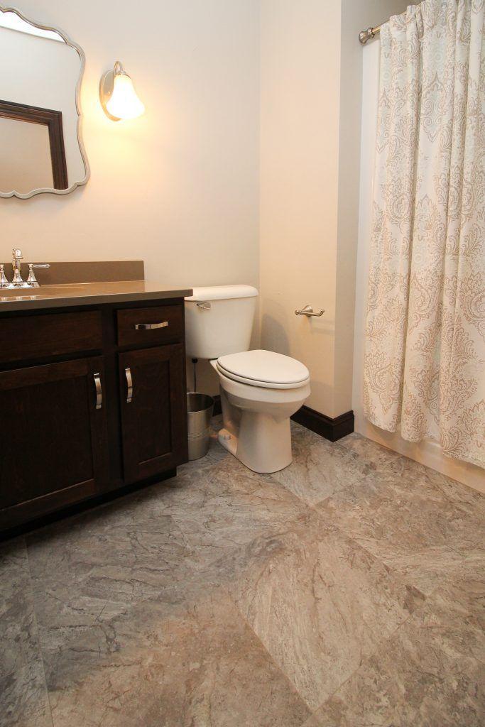 neutral luxury vinyl plank bathroom floor in 2020 with