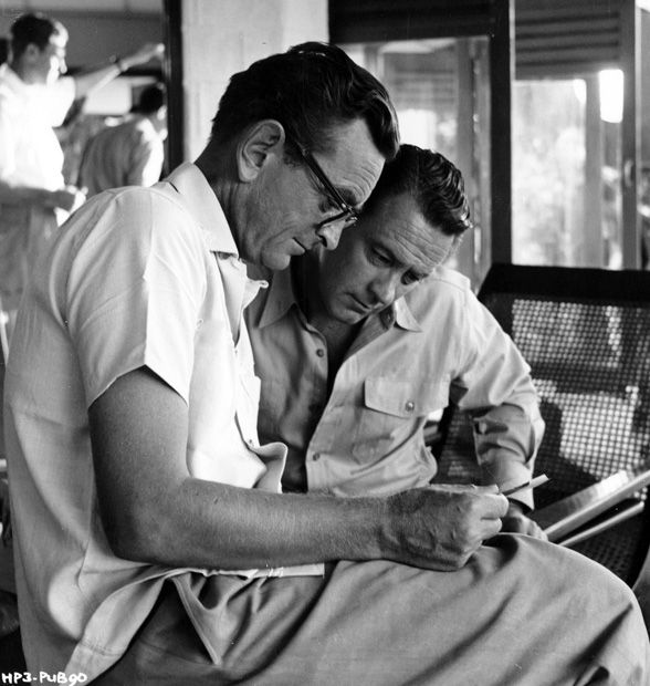"""Holden and director David Lean go over a scene on the set of """"The Bridge on the River Kwai"""""""