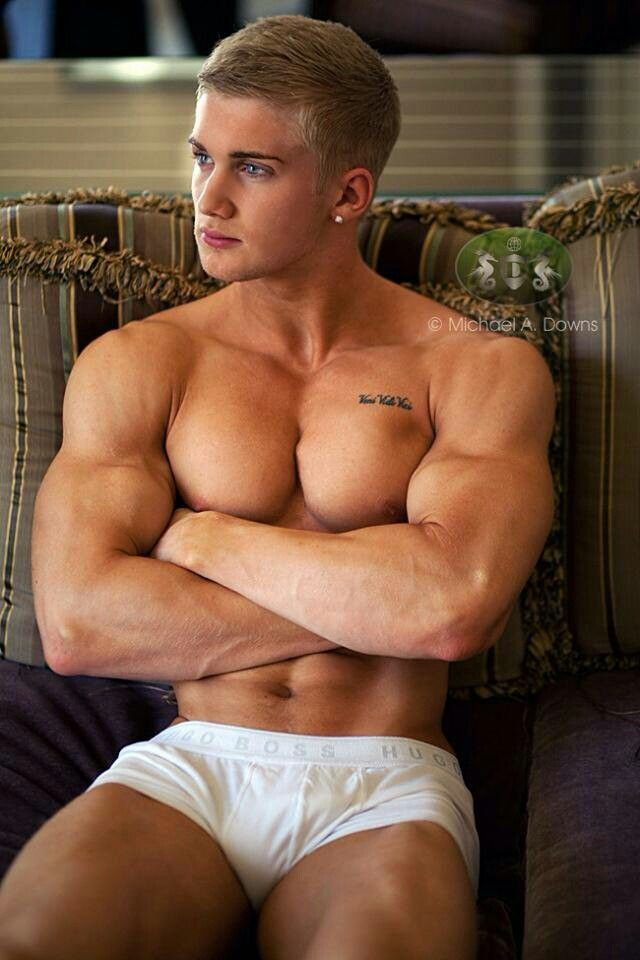 Muscular nude man with erection