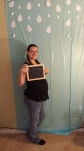 Photo booth... Table cloth and cardboard clouds with paper reason drops for a rain themed party www.mamabearscorner.net