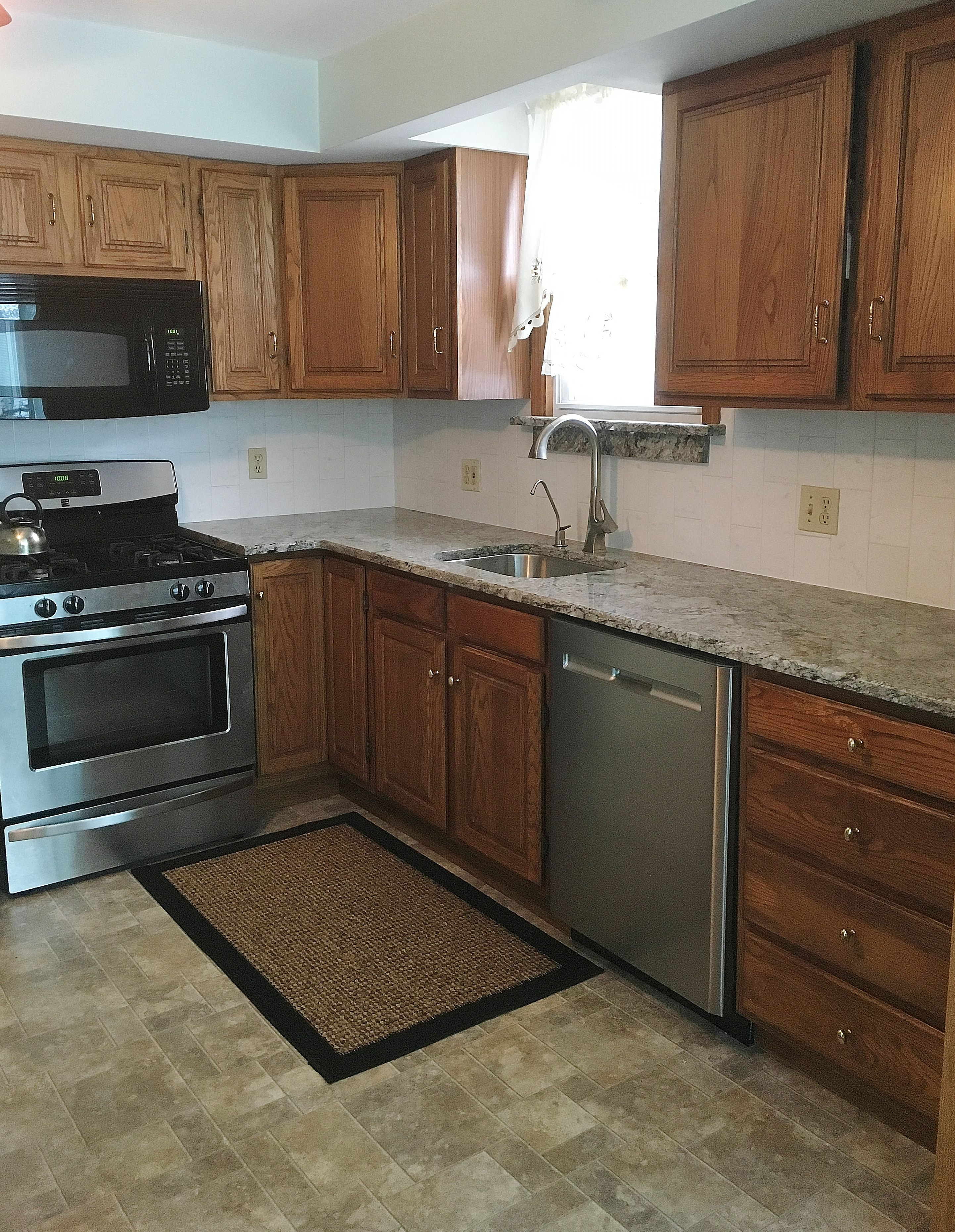 Small kitchen re-fresh by upgrading old laminate for new Blue Dunes ...