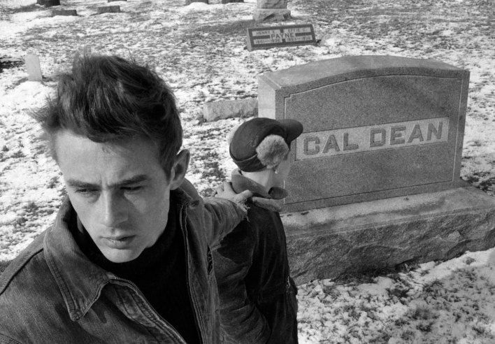James Dean in the Fairmount, Indiana, cemetery in 1955, where he found the grave of one of his ancestors with the same same name of the character, Cal, he played in East of Eden. Photo Dennis Stock